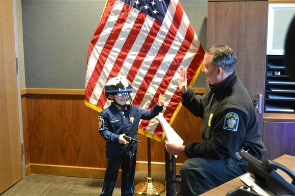 Bellevue Police Department Swears in Special Honorary Member